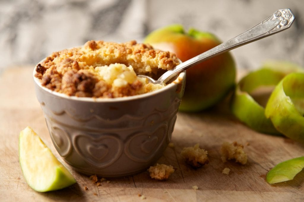 apple crumble on a cup on a rustic table. looks delicious